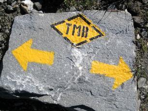 Tour du Mont Blanc sign on a rock